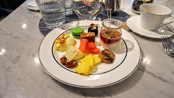 third plate, creme brulee, cookies, fruits and other desserts