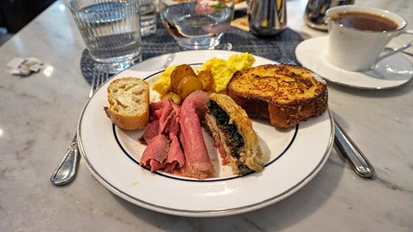 first plate, bread, scrambled eggs, wellington, roast beef